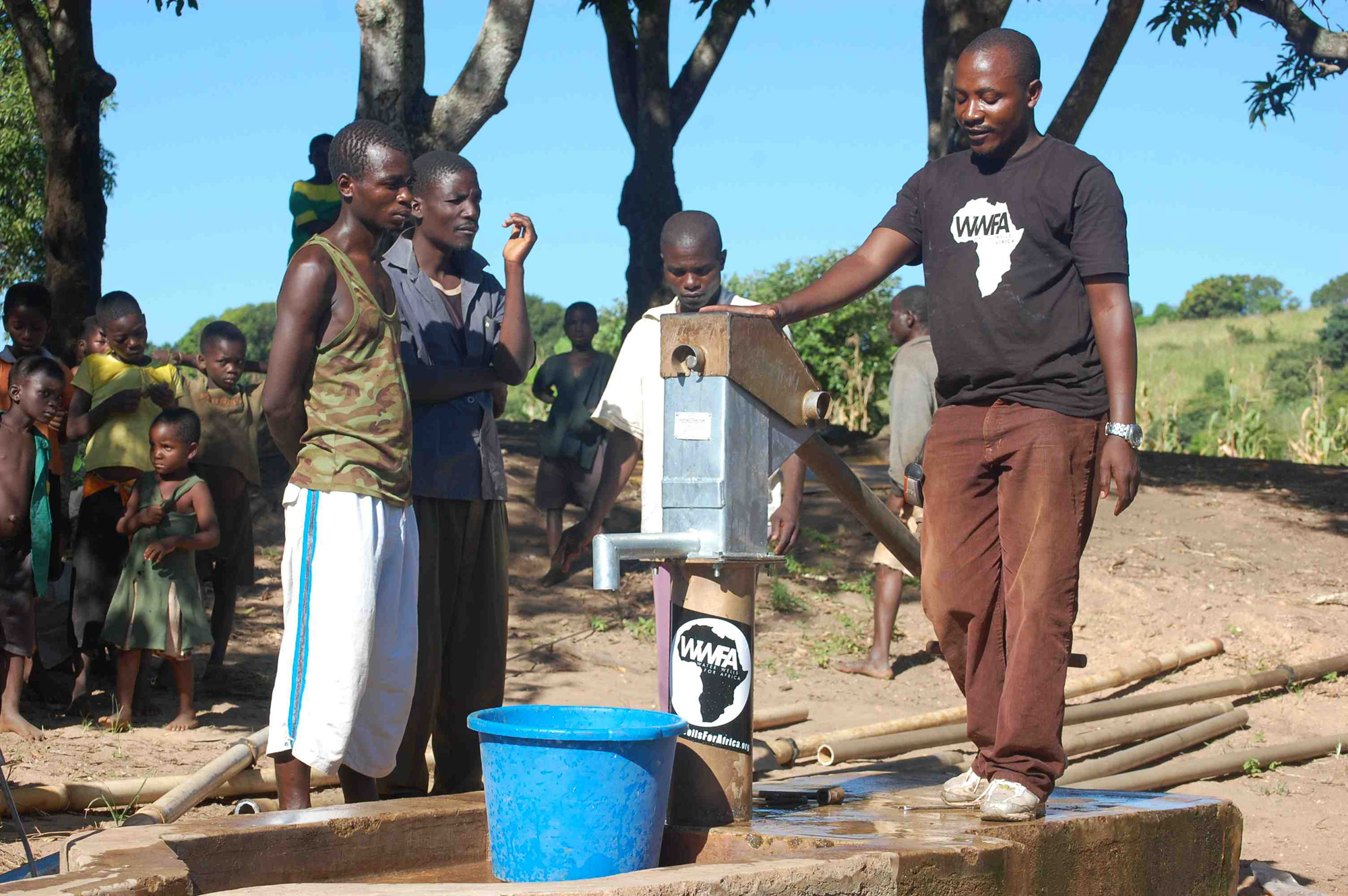 WWFA team member stands by and says a few words to thank the donors, and instruct the community in continued maintenance and care for the borehole.