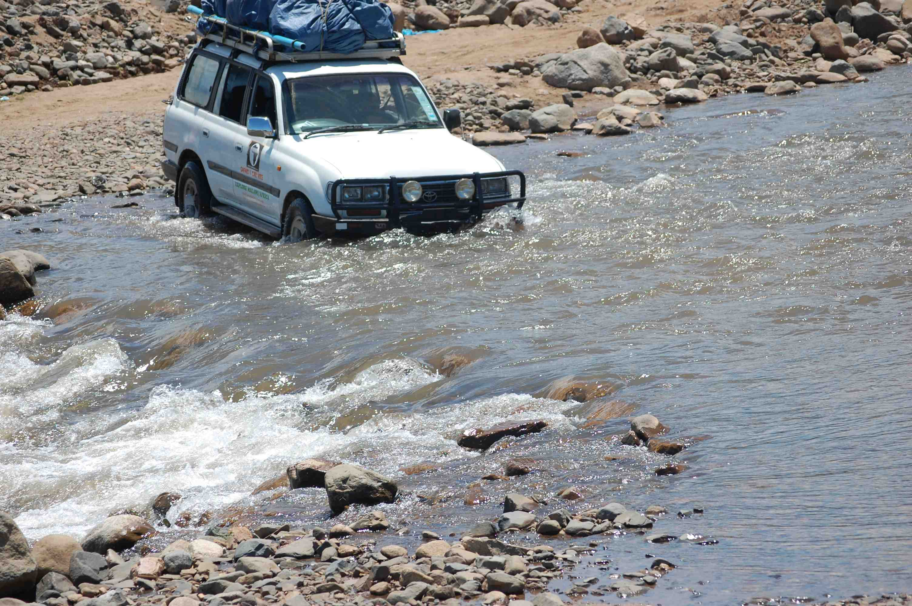 crossing-a-river-to-osiyana-camp